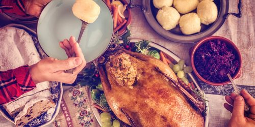 Traditional German holiday goose dinner with dumplings, red cabbage and stollen
